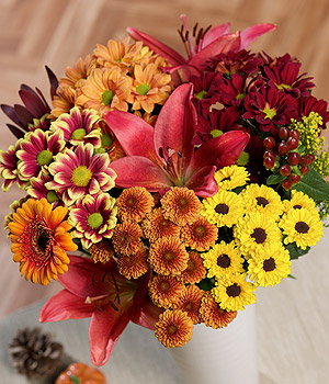 ../This beautiful bouquet includes red Asiatic Lilies, orange Germini, Solidago and Hypericum Berries.