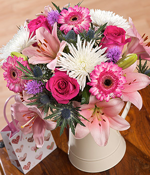 ../This gorgeous bouquet features pink Asiatic Lilies, Anastasia, two-tone pink Germini and cerise Roses.