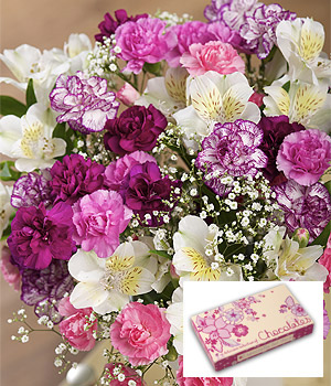 ../A bright and cheery bouquet of Spray Carnations and Alstroemeria with an 80g box of delicious filled chocolates.