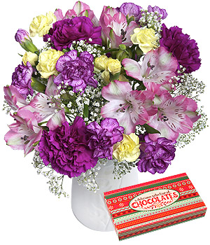 ../A bouquet of purple Carnations, pink Alstroemeria and Gypsophila with an 80g box of assorted chocolates.