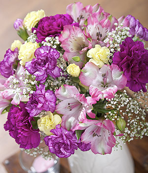 ../A classic bouquet of vivid purple Carnations, pink Alstroemeria and delicate white Gypsophila.