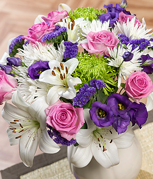 ../A stunning bouquet featuring beautiful pink Aqua Roses, white Asiatic Lilies and luxurious purple Lisianthus.