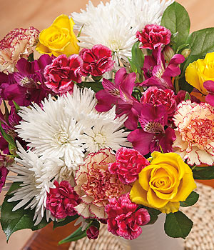 ../A colourful bouquet filled with yellow Roses, purple Alstromeria and Anastasia with Salal leaves.