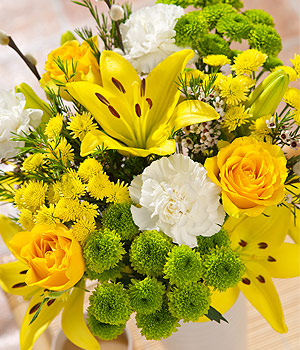 ../Three yellow Roses with white Carnations, yellow Asiatic Lilies and Wax Flower and Pussy Willow.