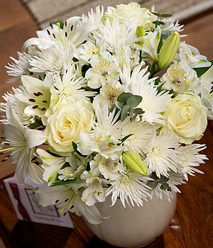 ../An elegant bouquet featuring white Avalanche Roses, Spray Anastasia, Asiatic Lilies and Eucalyptus.