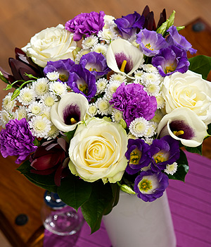 ../A truly luxurious bouquet featuring white Avalanche Roses and purple centred Picasso Calla Lilies.