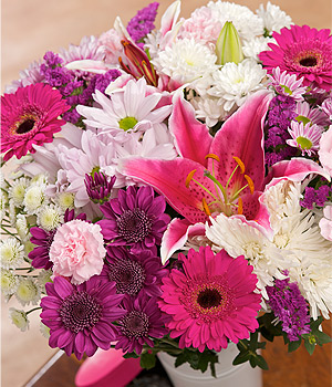 ../A gorgeous bouquet of Cerise Germini, pink Spray Carnations, Anastasia and an Oriental Lily.
