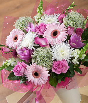 ../A truly luxurious feminine bouquet including a hot pink Calla Lily, exotic Alismatifolia and Aqua Roses.