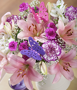 ../Pink Asiatic Lilies, Rendezvous Carnations and spray Carnations create this stunning bouquet.
