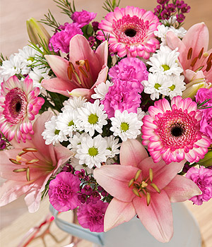 ../A gorgeous bouquet with Germini, Spray Carnations and pink Phlox in a variety of pretty pink shades.