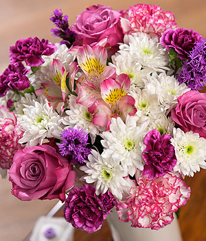 ../A fresh, pastel luxury bouquet with pink Roses, Alstroemeria with cerise Spray Carnations and purple Liatris.